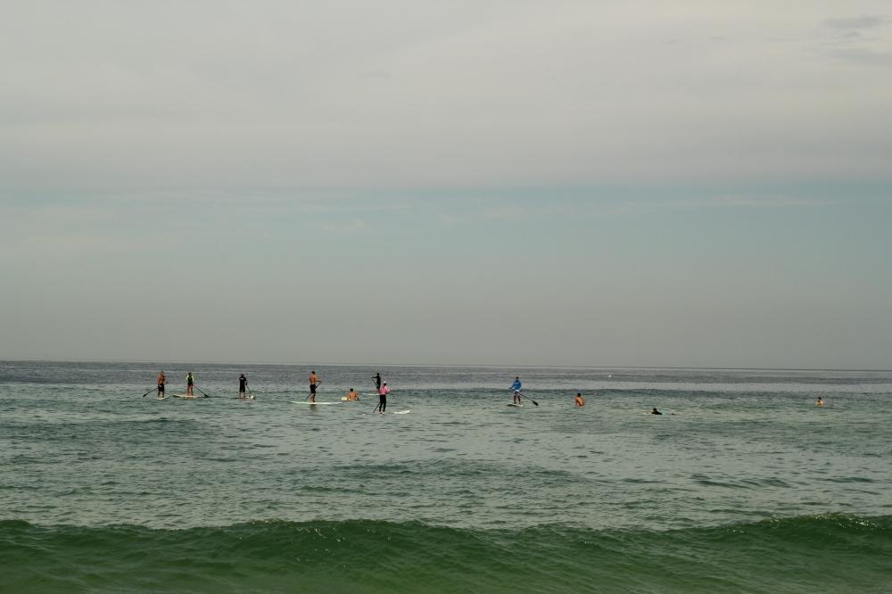 SUP surfers in Barra da Tijuca beach